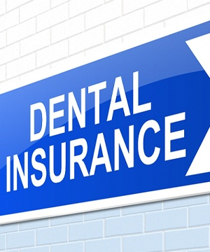 Dental insurance sign on brisk wall.