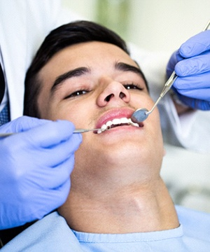 Male patient attending checkup with United Concordia dentist