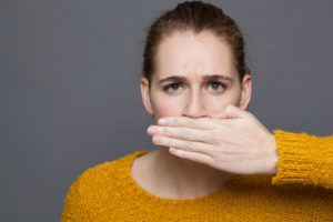 Woman hiding bad breath