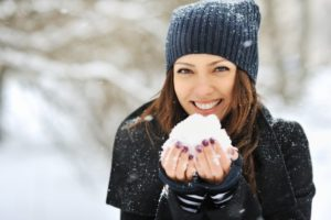 Woman smiling in snow.